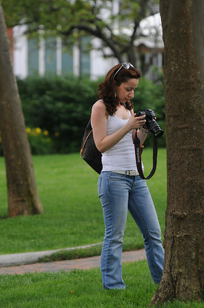 Newburyport: Mary , no last name given, check her camers view screen after taking some photos in Market Landing Park Saturday. Jim Vaiknoras/Staff photo