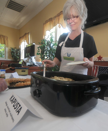 "Amesbury: Kate Broughton, Amesbury Days Chairperson, serves up Kapusta, a dish made with sauerkraut, mushrooms and onions at the ""Kielbasa Challenge"" at the Polish Club Saturday. The event was part of the Amesbury Days Celebration. Jim Vaiknoras/Staff photo"