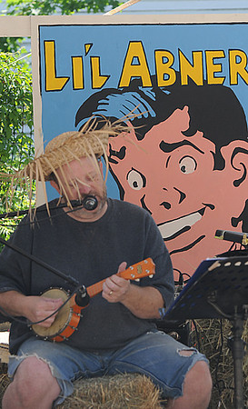 Amesbury:Carl Ayotte of the Lonesoms Pole Cats plays the Ukalele at the newly named Al Capp Amphitheater during Saturday's Amesbury Days Celebration. Jim Vaiknoras/Staff photo