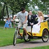 Newburyport: Kevin Murphy transports Bethany and Michael Russell just monents after they were married Sunday in Market Landing Park in Newburyport. The couple enjoyed the Pedicab ride to their reception at the Phoenix Room. Jim Vaiknoras/Staff photo