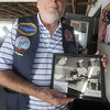 Seabrook: Submariner Dan Nicholson of Hampton NH who served on the USS Sailfish holds a photo of himself serving in the mess hall in 1956. Nicholson along with about 40 other submarine veterans gathered at the American Legion in Seabrook for a lobster dinner put on annually by Thrasher Base, a veterans organization out of Portsmouth. Jim Vaiknoras/Staff photo