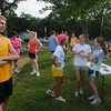 newburyport: Don Hennigar, far right, talks with runners before the weekly cross country race at Maudslay State Park in Newburyport. JIm Vaiknoras/Staff photo