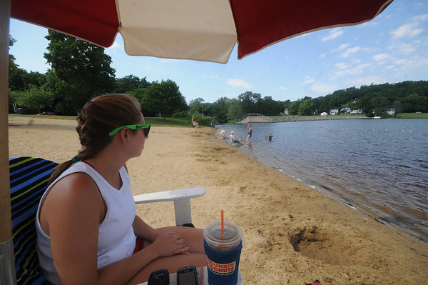 Amesbury: Life Guard Leeanne Moses keeps an eye on swimmers at Lake Gardner Sunday morning. Jim Vaiknoras/Staff photo