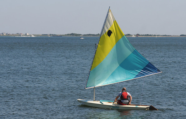 Newbury: A Sunfish glides along Joppa Saturday morning. Jim Vaiknoras/Staff photo
