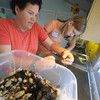 Newbury:  Lisa Hutchings and Molly McFlaney, 12 remove critters from the 50 gallon mini aquarium at the Audubon Society Joppa Flats Education Center Sunday. They were removing the animal so they could clean the tank. Jim Vaiknoras/Staff photo