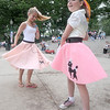 Amesbury:Addie Mainville, 12, and Kaitlin Fairchild, 8, dance in their poodle skirts at the Amesbury Day's Sock Hop at the Al Capp Amphitheater Friday night. Jim Vaiknoras/Staff photo