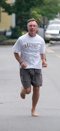 Newburyport: Barefoot runner Preston Curtis who will be running in the Yankee Homecoming Race next week. JIm Vaiknoras/staff photo