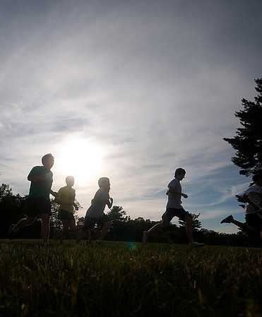 newburyport: Runners take off in the late afternoon at the weekly cross country race at Maudslay State Park in Newburyport. JIm Vaiknoras/Staff photo