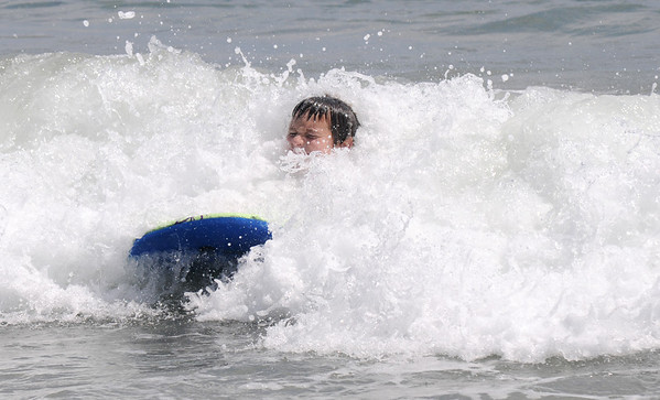 Salisbury: Harry Nichols, 10, body surfs on Salisbury Beach Saturday morning, Jim Vaiknoras/Staff photo
