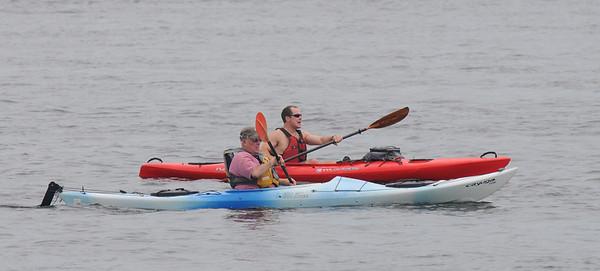 Newburyport: Kayakers glide along the Merrimack River near the Market Landing Park in Newburyport Sunday. Jim Vaiknoras/Staff photo