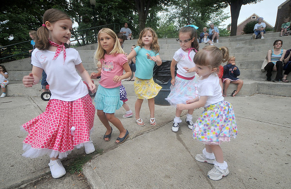 Amesbury: Gianna Surpentant, 6,  Taylor Papas. 5, Hannah Gale, 5, Hayden Talbot ,5,  and Liv Talbot, 2, do the twist at the Amesbury Day's Sock Hop at the Al Capp Amphitheater Friday night. Jim Vaiknoras/Staff photo