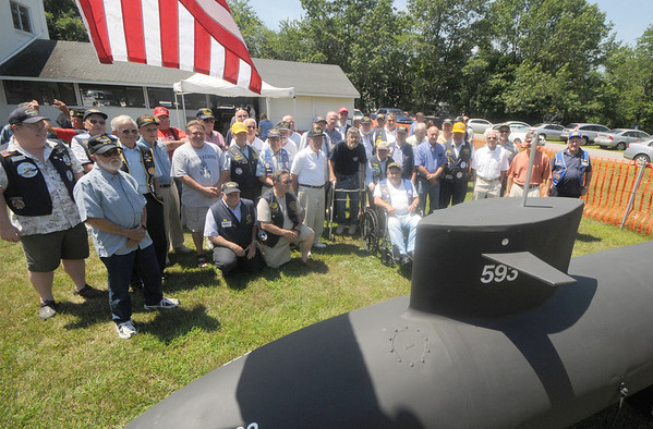 Seabrook: A group of submariners look over a model of a Dolphin class sub Saturday afternoon. The submarine veterans gathered at the American Legion in Seabrook for a lobster dinner put on annually by Thrasher Base, a veterans organization out of Portsmouth. Jim Vaiknoras/Staff photo