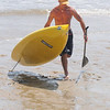 Salisbury: John O'Hara finishes first in the Altlantic Paddle Battle Race on Salisbury Beach Saturday. The race was part of the Surf Music and Art Fest at tthe beach. jim Vaiknoras/Staff photo