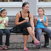 Newburyport: Eloidie Laferriere enjoys an ice coffee in Market Square  as Bailey Nadeau,8,  on the left eats a Snickers ice cream and her twin sister Isabella eats a cup off Moose Track ice cream on a warm night in Newburyport.  JIm Vaiknoras/Staff photo