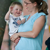 """Amesbury:Harrison Sullivan, 1, dances with his mom Bethany as they listen to Beatles tribute band """" All Together Now"""" perform at the Al Capp Amphitheater at the Millyard in Amesbury  Thursday night. Jim Vaiknoras/Staff photo"""
