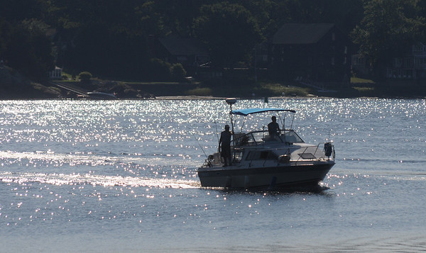Amesbury: A small fishing boat head up the Merrimack River past Alliance Park in Amesbury early Sunday morning. Jim Vaiknoras/Staff photo