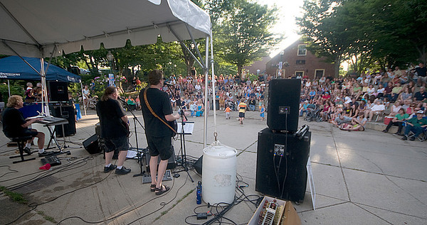 """Amesbury: Beatles tribute band """" All Together Now"""" perform at the Al Capp Amphitheater at the Millyard in Amesbury  Thursday night. Jim Vaiknoras/Staff photo"""