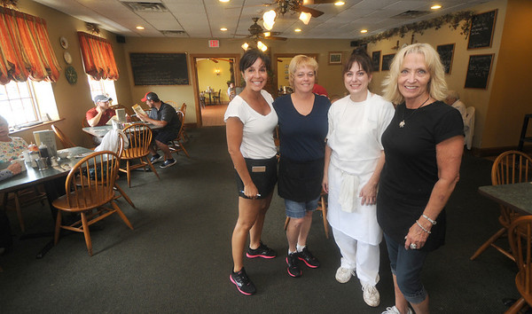 Amesbury: Waitress Andea Ethier, Sandy LeBlance, owner Patricia Carey, and waitress Krystal Cole at the Hollow Cafe in Amesbury. The business and condo is scheduled for a foreclosure auction next week.. Jim Vaiknoras/staff photo