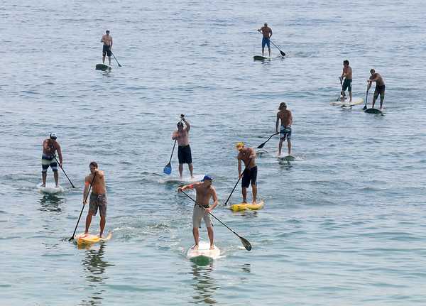Salisbury: Paddlers race to the finish in the Altlantic Paddle Battle Race on Salisbury Beach Saturday. The race was part of the Surf Music and Art Fest at tthe beach. jim Vaiknoras/Staff photo