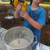 Amesbury: Bryson Lund, 9, uses a power drill and a paint mixer to stir pancake batter at annual Pancakes Under the Pines in Amesbury Monday morning. Jim Vaiknoras/Staff photo