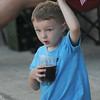 Amesbury: Maddox Moscardini, 3, wave the flag as he has a drink and enjoys  the music of  EJ & Crazy Maggy at the Al Capp Amphitheater at the Mill Yard in Amesbury. Jim Vaiknoras/Staff photo