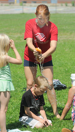Salisbury: Cameron Paquette, 6,  gets soaked by councilor Nicole Carter during a game of Drip, Drip, Drop, a water version of Duck, Duck, Goose. at the Boys and Girls Club in Salisbury Friday. Jim Vaiknoras/Staff photo