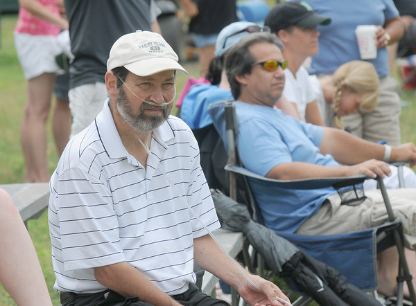 Rowley:Coach Dave Nye watches the Babe Ruth Allstar game Saturday at Eiros Field in Rowley. The game doubled as a fundraiser for Nye who has luekemia  Jim Vaiknoras/staff photo