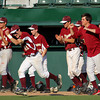 Lynn: The Newburyport bench rushes onto the diamond after the Clippers recorded the final out in their 4-1 win over Apponequet in the Eastern Mass State Final game at Fraser Field in Lynn. Photo by Ben Laing/Staff Photo