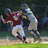 Newburyport: Newburyport's Brett Fontaine (6) is interferred with on his way to home plate by the Austin Prep catcher. Fontaine would eventually tag home plate to score the run. Photo by Ben Laing/Staff Photo