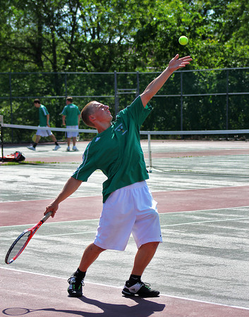 West Newbury: Pentucket's Pat Dahn sends a serve to his opponent from Bedford during Monday afternoon's state tournament match in West Newbury. Photo by Ben Laing/Staff Photo