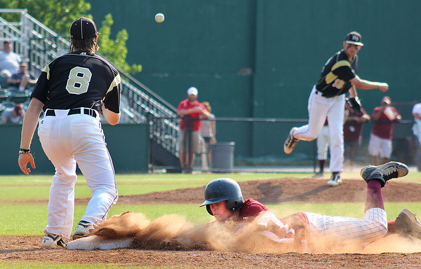 Lynn: Newburyport's Sam Barlowe (8) slides safely back into first base during Wednesday's 3-0 win over Bishop Fenwick at Fraser Field in Lynn. Photo by Ben Laing/Staff Photo