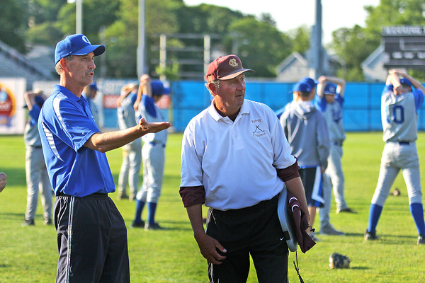 Lynn: Newburyport head coach Bill Pettingell speaks with his former player and current Georgetown head coach Mark Rowe in between games Wednesday afternoon at Fraser Field in Lynn. The Clippers defeated their opponent, Apponequet, 4-1 in the opening game, with Georgetown taking on Cohasset in the second game. Photo by Ben Laing/Staff Photo