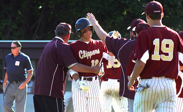 Newburyport: Colton Fontaine (18) of Newburyport, gets congratulated after scoring a run during Monday's game against Austin Prep. Photo by Ben Laing/Staff Photo