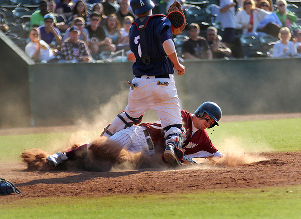 Lynn: Despite safely beating the tag from Apponequet catcher Chris Travers (7), Newburyport's Jim Conway (2) was called out at home plate late in Wednesday game at Fraser Field in Lynn. The Clippers would overcome the call, and win the game 4-1. Photo by Ben Laing/Staff Photo