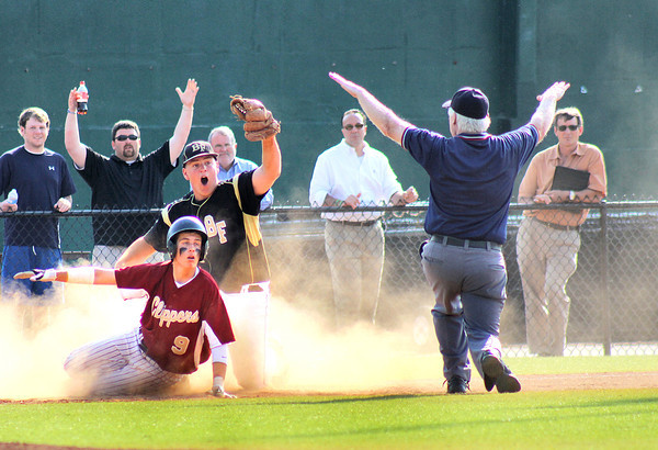 Lynn: Newburyport's Colby Morris (9) and Bishop Fenwick's Jake Bugler (4) looks to the umpire after a close play at thrid base during Wednesday afternoon's 3-0 Clipper win at Fraser Field in Lynn. Photo by Ben Laing/Staff Photo