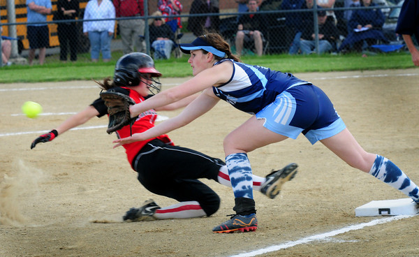 Byfield: Marblehead's Kathryn DiGiammarino slides safely into third as Jen Delaney waits for the throw. Bryan Eaton/Staff Photo
