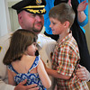 Merrimac: New Merrimac Police Chief Eric Shears hugs his children, Katelyn, 5, left, and Ryan, 6, after they pinned his badge on his shirt yesterday before being sworn in. Bryan Eaton/Staff Photo