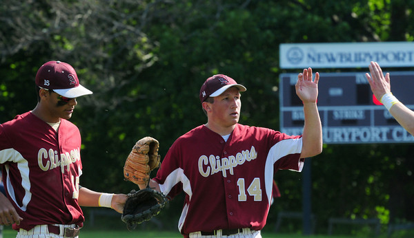 Newburyport: Newburyport's Ryan O'Connor gets the high five after closing out the top of the second striking out the opponent. Bryan Eaton/Staff Photo
