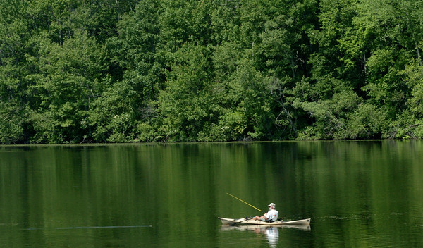 Amesbury: A fisherman has Lake Gardner in Amesbury to himself for a nice day in the sun yesterday afternoon. The weather changes today as showers are in the forecast. Bryan Eaton/Staff Photo