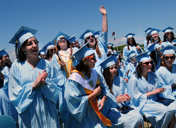 Byfield: Triton High graduates cheers as the last of the diplomas are passed out. Bryan Eaton/Staff Photo
