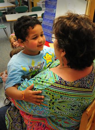 Salisbury: Jair Rodriquez, 5, says goodbye to his kindergarten teacher, Pauline Carrier, yesterday at Salisbury Elementary School. It was the last day of school for the Triton Regional School District. Bryan Eaton/Staff Photo