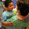 Salisbury: Jair Rodriquez, 5, says goodbye to his kindergarten teacher, Pauline Carrier, yesterday at Salisbury Elementary School. It was the last day of school for the Triton Regional School District. Bryan Eaton/Staff Photo