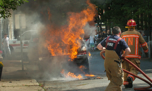 Newburyport: Newburyport firefighters arrive on the scene of a truck totally engulfed in flames on Independent Street which runs on the north side of the Tannery complex yesterday morning. No homes were damaged in the thickly settled area. Bryan Eaton/Staff Photo