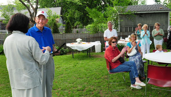 Newburyport: Ralph Ayers is applauded as he recieved Senior Volunteer of the Year award from Mayor Donna Holaday. The award was bestowed at an afternoon tea behind the Emma Andrews Library Branch in Newburyport's South End yesterday afternoon. Bryan Eaton/Staff Photo