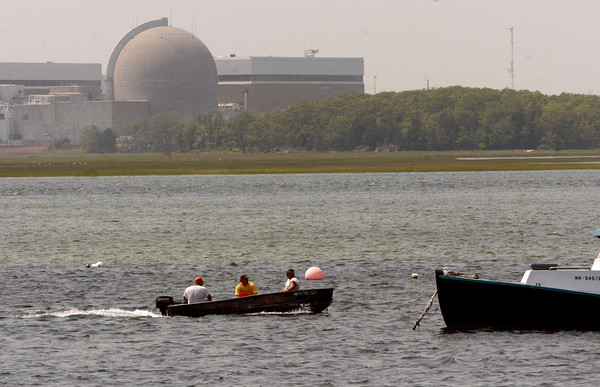 Seabrook: Fisherman motor past the nuclear power plant in Seabrook which has had its underground tunnel damaged by water seepage. Bryan Eaton/Staff Photo