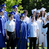 Goergetown: Georgetown High Senior Chorus sings the National Anthem at the beginning of graduation on Saturday. Bryan Eaton/Staff Photo