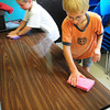 Amesbury: Students in Cathy Patten's class at Amesbury Elementary School helped out tidy the classroom before school was released yesterday afternoon. Cleaning off one of the work tables are Grady Childs, left, and Brady Dore, both 8. Bryan Eaton/Staff Photo