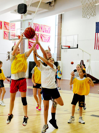 Newburyport: Scores of girls attended the Clipper Girls Basketball Camp at Newburyport High yesterday, which opened on Monday. Bryan Eaton/Staff Photo