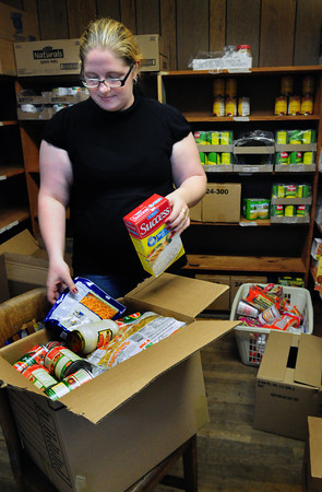 Amesbury: Phylicia Valliere helps pack food items at the Community Action Council in Amesbury for their move to new headquarters around the corner on Friend Street near the town's municipal lot. Bryan Eaton/Staff Photo