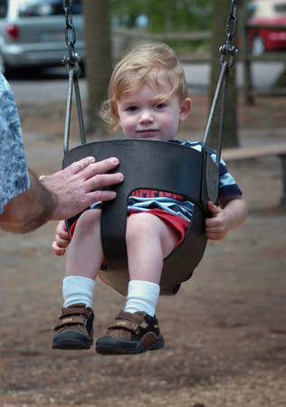 Newburyport: Thomas Duratti, 18 months, of Newburyport gets a push from his dad, Mike. The two were exploring the playground equipment at Moseley Woods in Newburyport. Bryan Eaton/Staff Photo